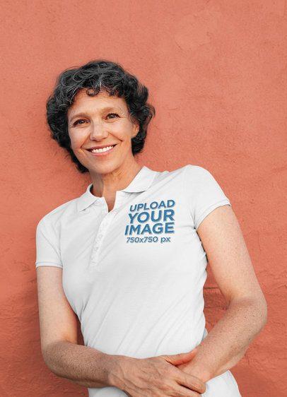 Polo Shirt Mockup of a Senior Woman Leaning on a Wall 39129-r-el2