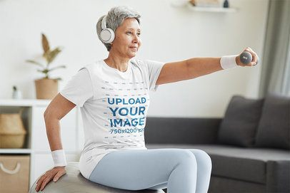 T-Shirt Mockup of a Senior Woman Working Out at Home 39621-r-el2