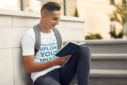 Tee Mockup of a Student Reading a Book by Some Stairs 39173-r-el2