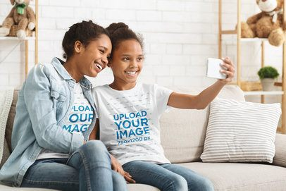 T-Shirt Mockup Featuring Two Sisters Taking a Selfie at Home 39062-r-el2