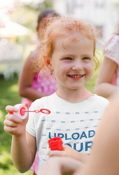 T-Shirt Mockup of a Little Girl Blowing Bubbles 39284-r-el2