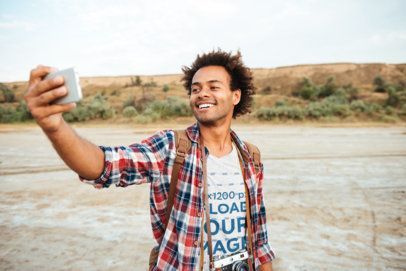 Heather Tee Mockup of a Happy Man Taking a Selfie 39348-r-el2