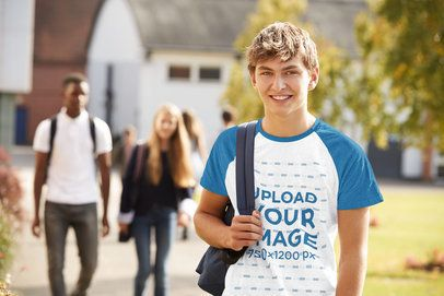 Mockup of a Teenager Wearing a Raglan T-Shirt Outside School 39083-r-el2
