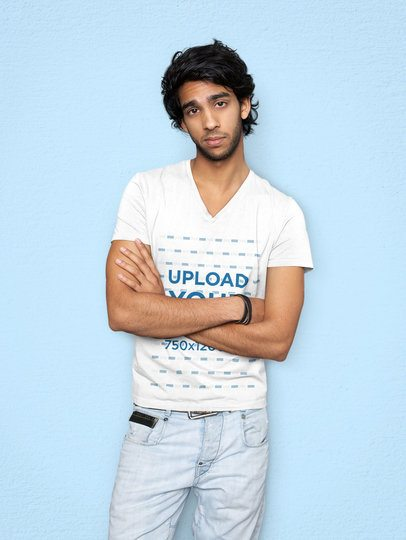 Mockup of a Man Wearing a Customizable V-Neck T-Shirt and Posing Against a Plain Backdrop 39510-r-el2