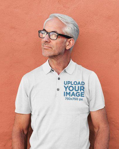Polo Shirt Mockup of a Senior Man Against a Plain Wall 39267-r-el2