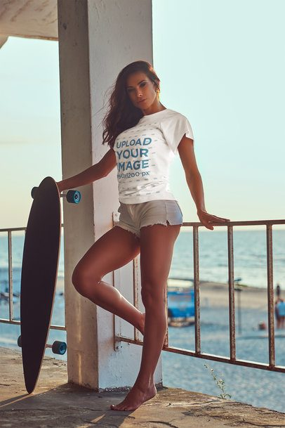 T-Shirt Mockup of a Woman with a Longboard by the Beach 38045-r-el2