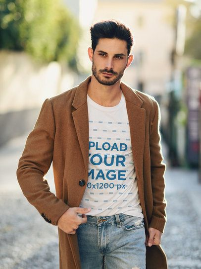 T-Shirt Mockup of a Trendy Man with a Coat Walking on the Street 37634-r-el2