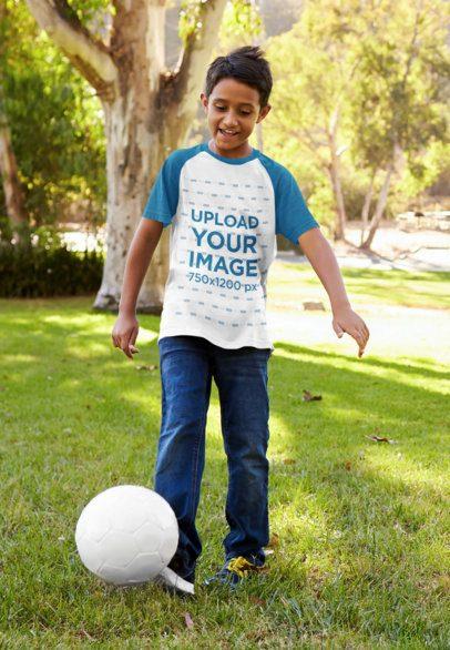 Raglan Tee Mockup Featuring a Kid Playing with a Soccer Ball 39392-r-el2