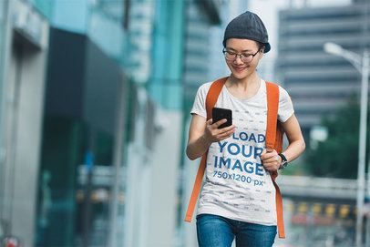 T-Shirt Mockup Featuring a Smiling Woman Checking Her Phone 37574-r-el2