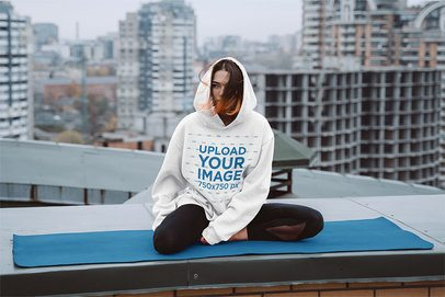 Mockup of a Woman with an Oversize Hoodie Sitting at the Rooftop 38668-r-el2