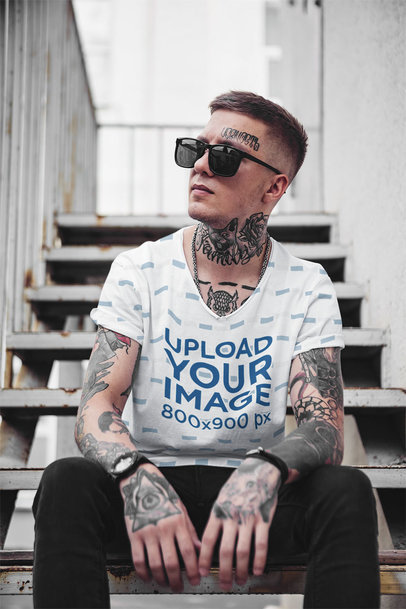 Mockup of a Man with a Sublimated V-Neck Tee Sitting on the Stairs 35245-r-el2
