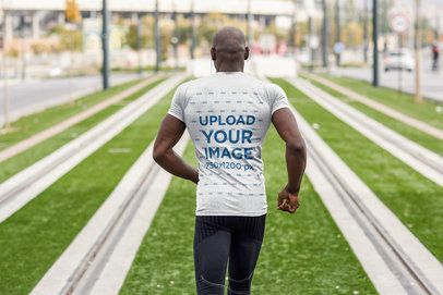 Back-View Mockup of a Man Jogging at a Sports Field 38095-r-el2