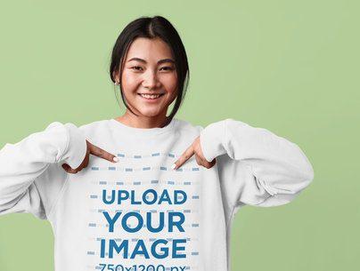 Studio Mockup of a Woman Pointing at Her Sweatshirt 37660-r-el2