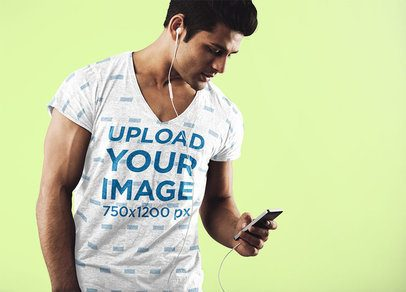 V-Neck T-Shirt Mockup of a Man with His Phone in a Studio 34791-r-el2