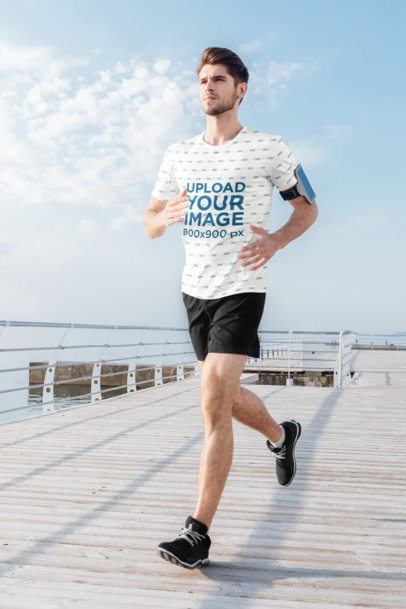 Sublimated T-Shirt Mockup of a Man Running on a Pier 36232-r-el2