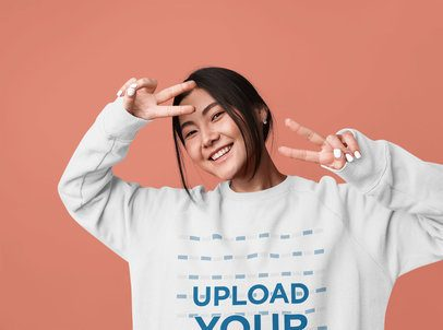 Crewneck Sweatshirt Mockup of a Happy Woman in a Studio 39463-r-el2