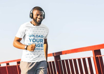 T-Shirt Mockup of a Happy Man Running While Listening to Music 38817-r-el2