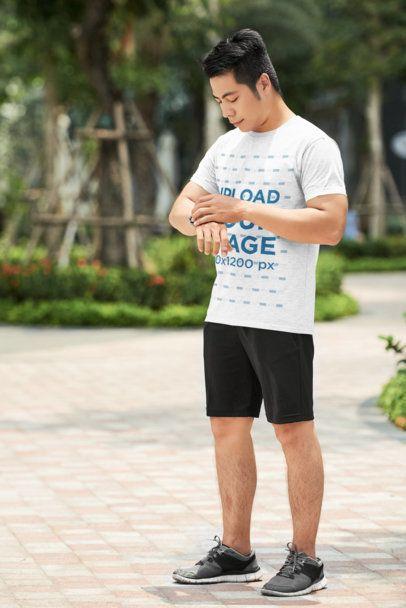 T-Shirt Mockup of a Man Checking His Watch 36216-r-el2