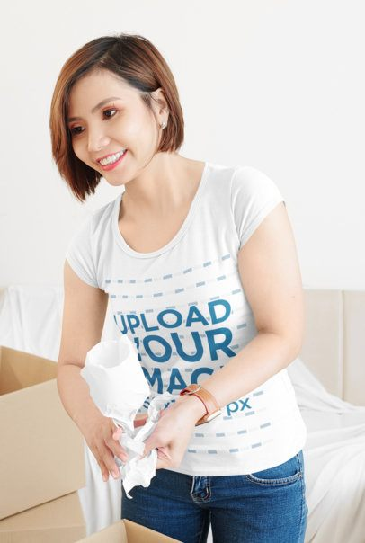 Scoop-Neck T-Shirt Mockup of a Woman Packing Some Things 36219-r-el2