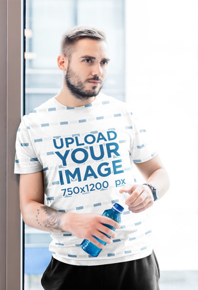 Mockup of a Tattooed Man Wearing a Sublimated T-Shirt 35202-r-el2