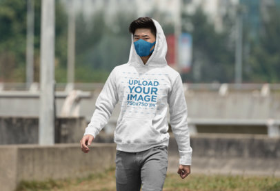 Mockup of a Man Walking on a Street with a Pullover Hoodie 36259-r-el2