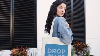 Stop Motion Tote Bag Partially Shown Held By Pretty Girl Outside Her House Mockup a13642