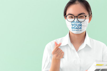 Face Mask Mockup of a Young Woman Doing a Finger Heart 39811-r-el2