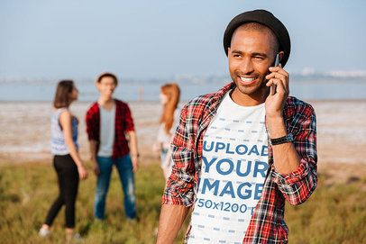 Round-Neck Tee Mockup Featuring a Smiling Man Talking on His Mobile 34851-r-el2