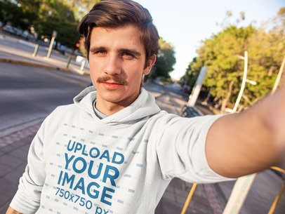 Selfie Mockup Featuring a Man with a Moustache Wearing a Hoodie 13610