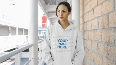 Young Woman Wearing Pullover Hoodie On A Sports Place Hallway Mockup Video a13207