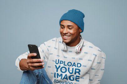 Sublimated Sweatshirt Mockup of a Happy Man Checking His Phone 37664-r-el2