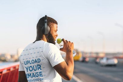 T-Shirt Mockup of the Back View of a Runner Drinking Some Water 38823-r-el2