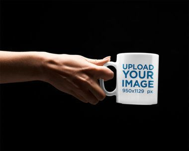 Mockup Featuring a Woman's Hand Holding an 11 oz Coffee Mug 36004-r-el2