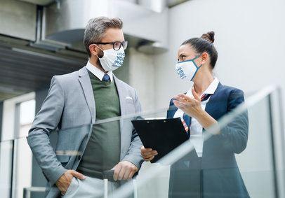 Face Mask Mockup of a Man and a Woman at an Airport 39653-r-el2