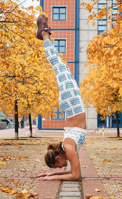Leggings and Sports Bra Mockup of a Woman Doing Yoga in a Pedestrian Zone 35030-r-el2