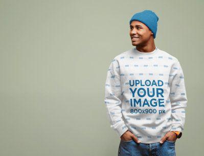 Mockup of a Man Wearing a Sublimated Crewneck Sweatshirt Against a Plain Background 37668-r-el2