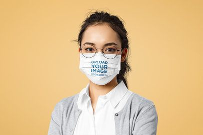 Face Mask Mockup of a Woman with Glasses in a Studio 41066-r-el2