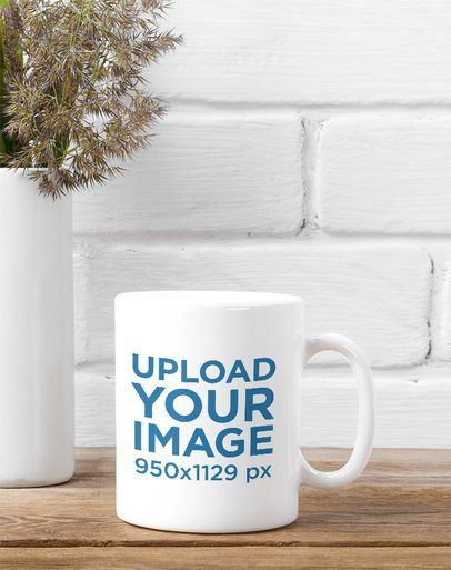Mockup of an 11 oz Coffee Mug Placed on a Rustic Table Next to a Vase 37282-r-el2