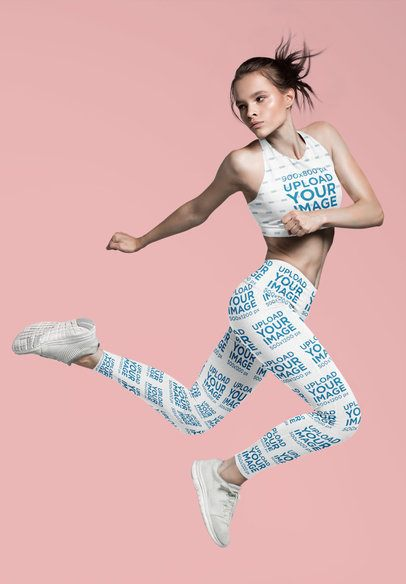 Sports Bra and Leggings Mockup of a Woman Jumping in a Studio 37595-r-el2