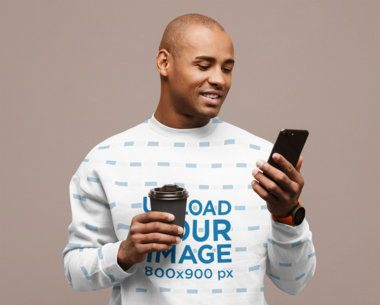 Sublimated Sweatshirt Mockup Featuring a Man Checking His Phone at a Studio 39667-r-el2