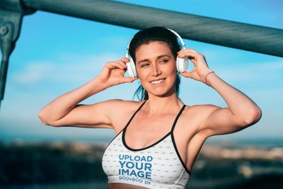Sports Bra Mockup of a Woman Putting on Headphones To Go for a Run 34954-r-el2