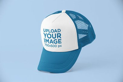 Mockup of a Trucker Hat Balancing on Its Bill 11751