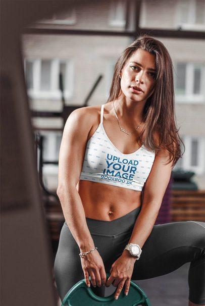 Sports Bra Mockup of a Woman Holding a Dumbbell Plate 35332-r-el2