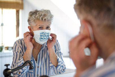 Face Mask Mockup of a Senior Woman Looking at the Mirror 40551-r-el2