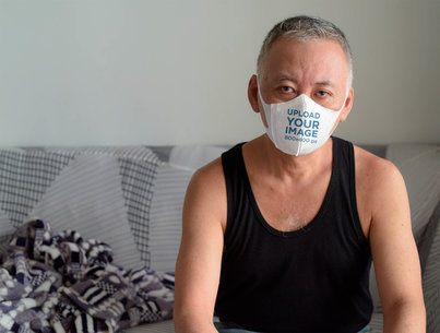 Face Mask Mockup Featuring a Man at Home 40882-r-el2
