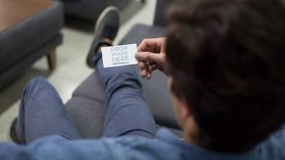Stop Motion Mockup Of A Guy Talking With His Phone And Looking At A Business Card a13707