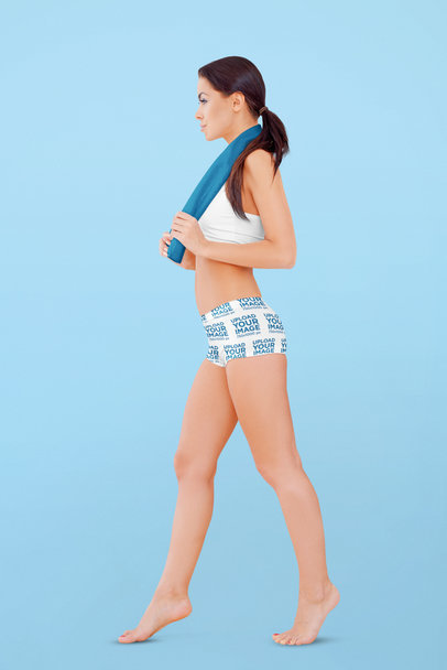 Bike Shorts Mockup of a Woman Walking Barefoot in a Studio 41473-r-el2
