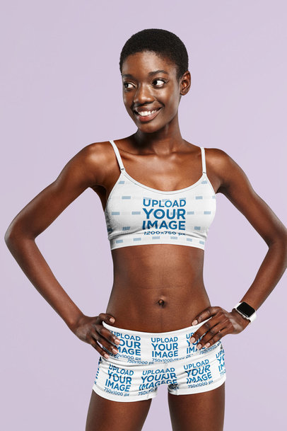 Mockup of a Happy Woman Wearing a Sports Bra and Shorts in a Studio 41178-r-el2