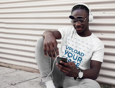 T-Shirt Mockup of a Man Listening Music on the Street 39921-r-el2