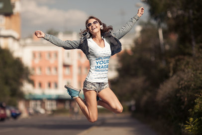 T-Shirt Mockup of a Happy Woman Jumping Around While Listening to Music 37593-r-el2